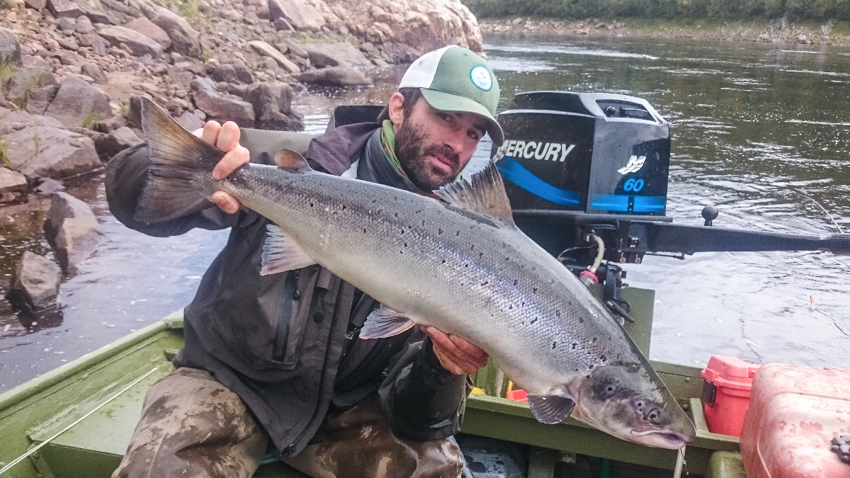 Ryabaga guide Agus with Bonnie's 17 pounds Salmon