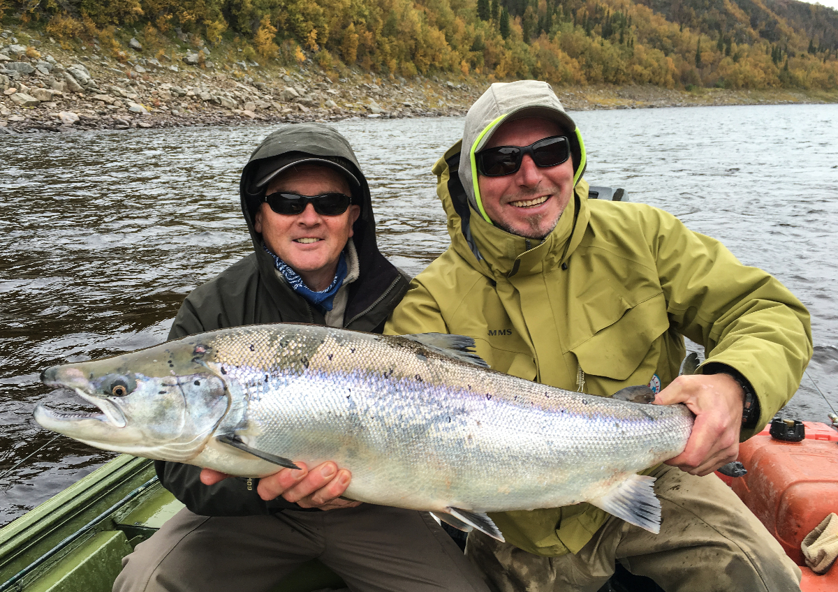 Joe Turley and guide Andrei with an 18 pounds fresh fish