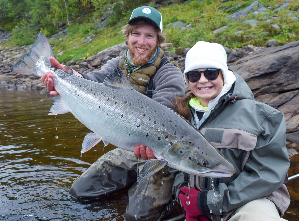 Max holding Sasha T's first Atlantic Salmon, Congratulations