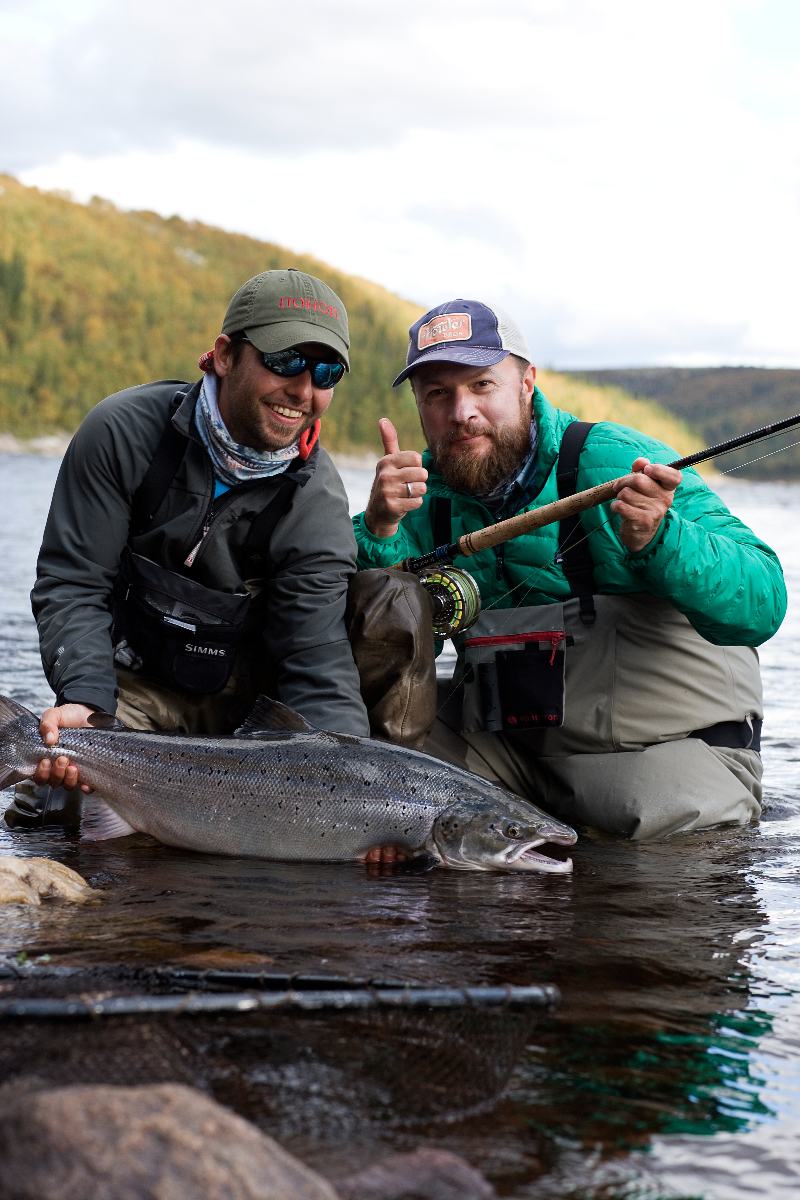PRC owner Ilya Sherbovich and guide Juan holding his stunning 19 lbs Fall run!